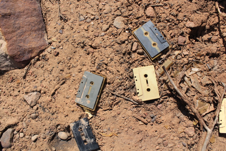 Old broken cassette tapes by proposed freeride trail.