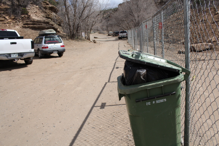 An overflowing trashcan is a common sight at Horse Gulch trail head.