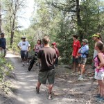A group of people discusses a proposal to designate Star Wars Trail as a one-way, mountain-bike specific trail.
