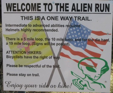 The Alien Run Trail on BLM land in New Mexico is designated as one way, althouth I'm sure that it's enforced by social pressure and trail signage more than any other way.