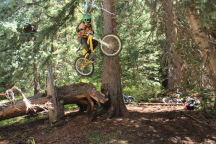 This is freeride. Nate Kirker hits a big booter on a freeride trail somewhere on the San Juan National Forest.
