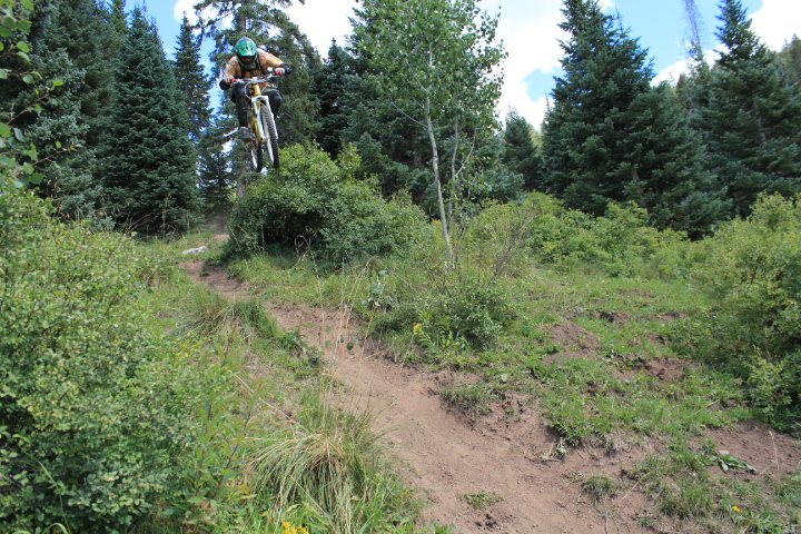 Nate Kirker jumps a bush on the sickest trail in the San Juans. Thank you for reading HGB!