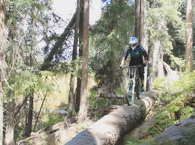 Mike Smith on a log ride at the undisclosed freeride trail in the San Juans.