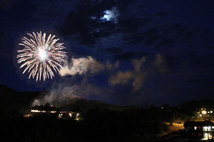 Looking towards Smelter Mountain and Manna Soup Kitchen, a firework explodes above Greenmount Cemetery.