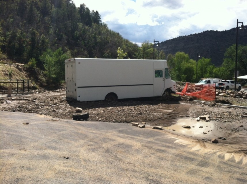 The Horse Gulch trailhead parking lot was flooded with mud and rocks Saturday evening. Photo by Jason Hotchkiss.