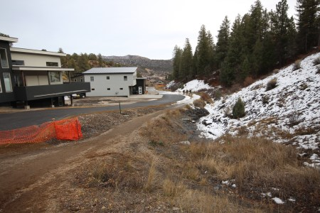 People walk up the trailhead at the end of Ella Villa Court. Currently, the trail lays by the driveways of two homes at the cul-de-sac, but will soon be rerouted to reflect the language of a trail easement signed Dec. 5, 2016.