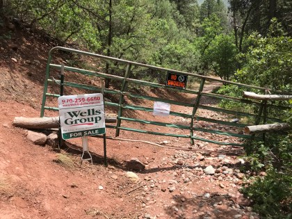 This gate with closure signage was installed by Ed Zink on Falls Creek Road at the border with National Forest lands.