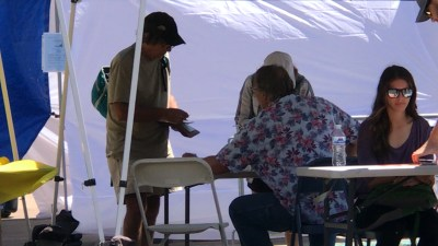 People giving up their medical information at a fundraiser event for United Way