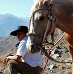 Horseback riding guide, arriero, and his horse