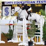 Margie Engle and Indigo were the winners of the $50,000 Grand Prix of Tampa CSI 2*-W after completing a clear round over the fences, but crossing the finish line with two time faults. Photo By: Anne Gittins.