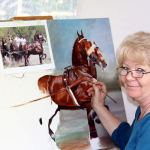 Equestrian artist Moe Hahn works on a painting of the combined driving horses that are part of Chester Weber's famous and award-winning four-in-hand team.