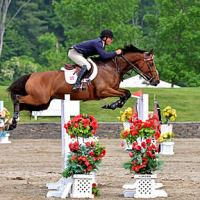 ©ESI Photography. Todd Minikus and Quality Girl in the $10,000 Brook Ledge Open Welcome