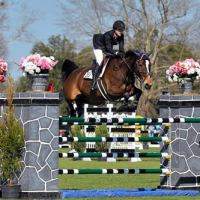 Frances Land sails over an oxer on the world class grass turf grand prix field.