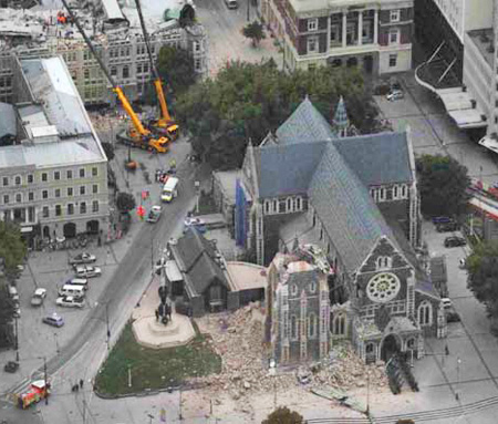 The Christchurch Cathedral in ruins. The Press building is at top left.