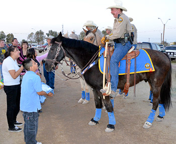Tommy and Chief Deputy Maj. Leon Wilmot greet visitors to the Yuma County Fair in Arizona.