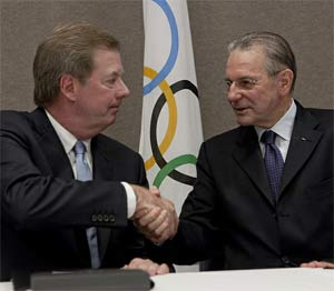 USOC President Larry Probst, left, and IOC President Jacques Rogge at the signing.