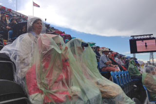 Thank goodness for plastic - spectators brave the weather at the second day of dressage.