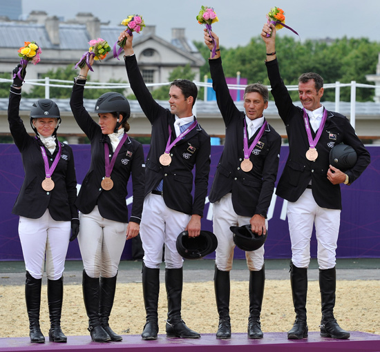 New Zealand's bronze medal team, from left, Jonelle Richards, Caroline Powell, Jonathan Paget, Andrew Nicholson, and Mark Todd.