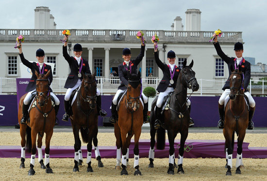 Britain's silver medal winning team, from left, Zara Phillips, Tina Cook, Mary King, Nicola Wilson, and William Fox-Pitt.