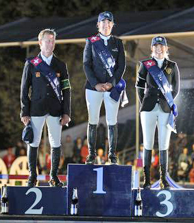 Laura Kraut stands atop the podium with Rolf-Goran B second, and Edwina Tops-Alexander third.
