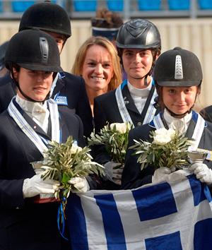 The Greek gold medal-winning children's team at the Balkan Dressage Championships (left to right ): Kyveli Tzortzaki, Vassilili Voltairou (partially obscured), chef d'equipe Emmanouella Mousamas, Melina Zografou Alexiou and Lyda-Evdokia Anesti.