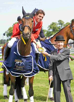 Germany's Kai Ruder receives his prize from George Lane Fox for winning the Bramham CCI3* in 2011.