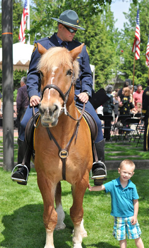 Police horse Ian with a young fan.