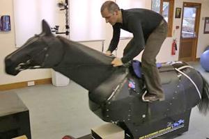 a jockey using a racehorse simulator