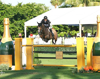 Kent Farrington and Dynamo jump over the Veuve Clicquot fence.
