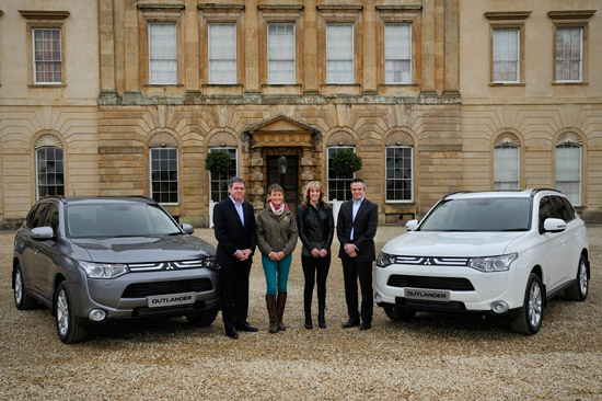 Mitsubishi Managing Director Lance Bradley, left, with Mistubishi Sales and Marketing Director Toby Marshall, present Mary King and Charlotte Dujardin with their new Mitsubishi Outlanders.