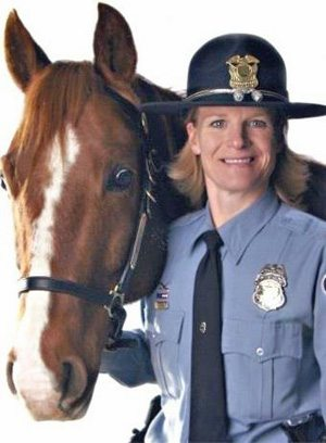 Wrangler with Mounted Patrol officer Lora Hanks.