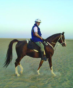 Dr Mohammad Al-Nujaifi on and endurance ride with the stallion Oreeo, one of his racehorses.