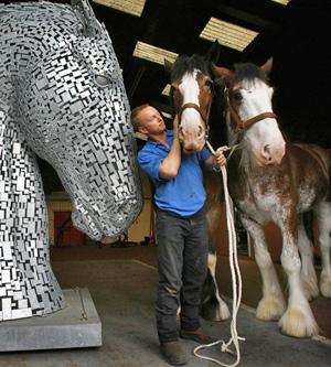 Sculptor Andy Scott with his inspiration.