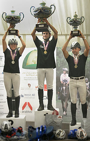 On the podium for the FEI World Endurance Championships for Young Horses are (L-R): Silver medalist Silvia Yebra Altimiras (ESP), gold medallist Aurelien Rocchia (FRA) and bronze medallist Laurent Mosti (FRA)
