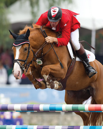 Showgirl, pictured here with Jonathan Asselin, has been purchased for Canadian show jumping athlete Yann Candele.