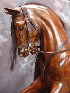 A Legends Cherry Rocking Horse.