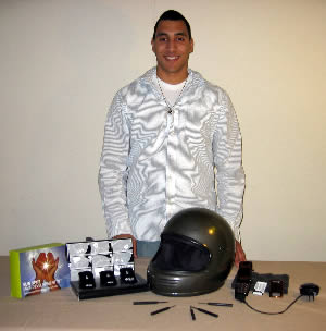 Engineering student Brycen Spencer with his safety helmet invention.