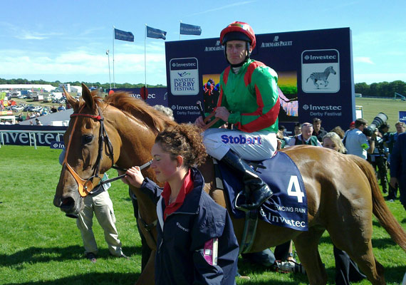 Jockey Johnny Murtagh and Dancing Rain return to winner's enclosure after winning the Oaks at Epsom in June 2011.