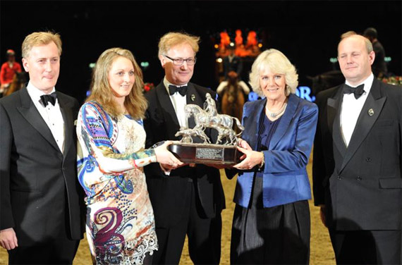 HRH The Duchess of Cornwall presents the Raymond Brooks-Ward trophy to Louise Saywell, accompanied by James, Simon and Nick Brooks-Ward.