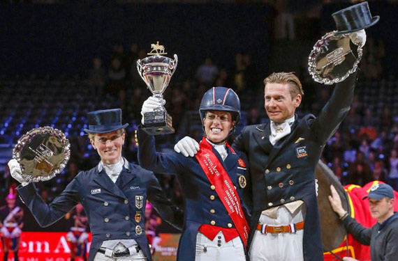 Great Britain's Charlotte Dujardin (centre) claimed the Reem Acra FEI World Cup™ Dressage 2014 title at Lyon, France today after a spectacular Freestyle performance with Valegro.  Pictured with her on the prize-winner's podium are (left) runner-up Germany's Helen Langehanenberg and (right) third-place Edward Gal from The Netherlands.  © FEI/Dirk Caremans
