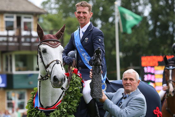 2013 Hickstead Derby winner Phillip Miller and Caritiar Z being presented with the Boomerang trophy by Harvey Smith.