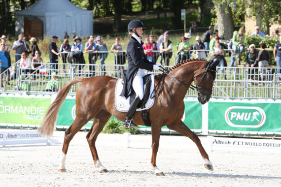 Germany's Sandra Auffarth and local horse Opgun Louvo lead the eventing competition after the second day of dressage in Normandy.