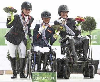 Grade II gold medalist Dutch rider Rixt van der Horst, with silver and bronze medalists Natasha Baker and Lauren Barwick.