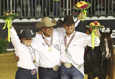 WEG individual reining medalists, all from the  USA; from left, Mandy McCutcheon (bronze) Shawn Flarida (gold), and Andrea Fappani (silver).