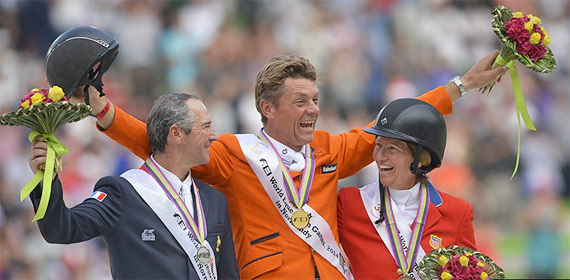 Gold medalist Jeroen Dubbeldam celebrates on the podium with Patrice Delaveau (silver) and Beezie Madden (bronze).