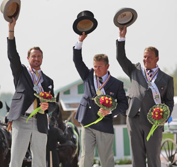 Individual Driving medallists, from left, silver medallist Chester Weber (USA); gold medallist and world champion Boyd Exell (AUS); and bronze medallist Theo Timmerman (NED).