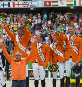 The Dutch claimed gold in the Jumping team championship on Thursday. L-R: Jeroen Dubbeldam, Gerco Schroder, Maikel van der Vleuten and Jur Vrieling with Chef d'Equipe Rob Ehrens.