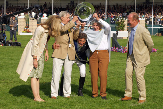 Andrew Nicholson, with owners Mark and Rosemary Barlow, is obviously very happy with his win!