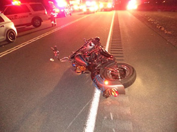 The rider of this motorcyclist was thrown into the path of oncoming traffic after colliding with a wild horse. Photo: Nevada Highway Patrol