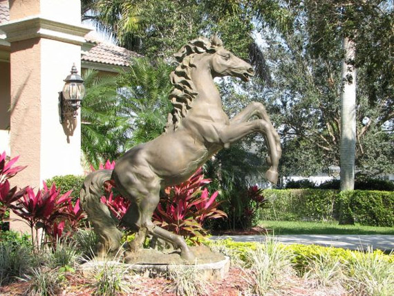 A horse sculpture stands guard amidst bright landscaping in front of the property in Draft Horse Lane. Photos: Destiny International Properties